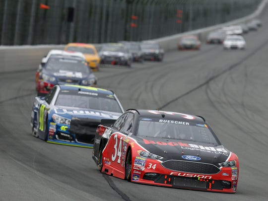NASCAR Sprint Cup Series driver Chris Buescher (34) races during the Pennsylvania 400 at Pocono Raceway on Monday.
