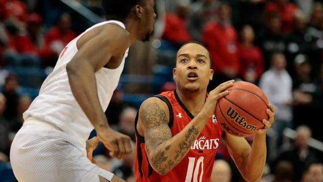 Cincinnati Bearcats guard Troy Caupain (10) looks for an opening in the first half of the American Athletic Conference Tournament Championship game between the Southern Methodist Mustangs (1) and the Cincinnati Bearcats (2) at the XL Center in Hartford, Conn., on Sunday, March 12, 2017. At halftime the Mustangs led UC 32-23.