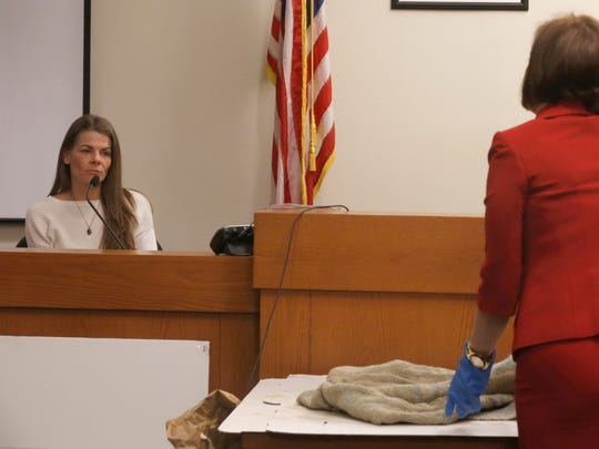 Danielle Gerding testifies Thursday during the Michelle Lodzinski murder trial. She is one of three people who can identify the blue blanket found near Timothy Wiltsey's remains. Lodzinski, a former South Amboy resident charged with the murder  of her 5-year-old son more than 20 years ago, appears before Superior Court Judge Dennis Nieves in New Brunswick.