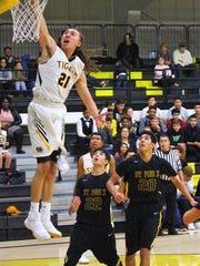 Alamogordo's Rakim Stokes slams down a dunk during