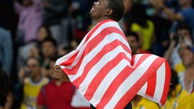 Kevin Durant wears the United States flag after defeating Serbia during the Men's Gold medal game