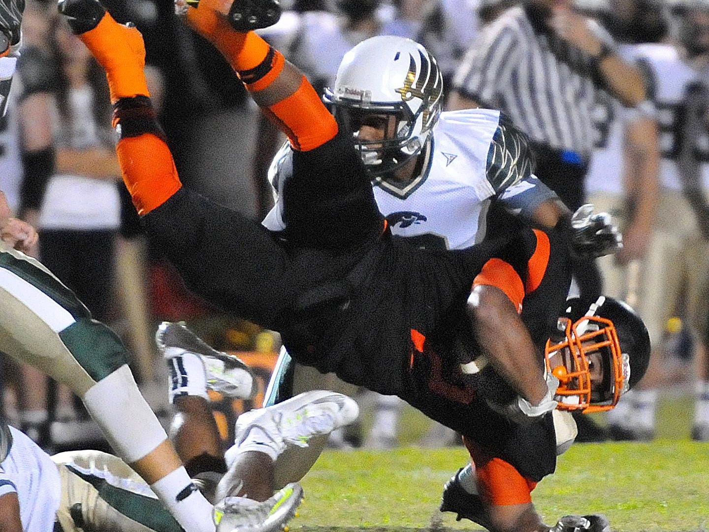 Cocoa High's Timmy Pratt is up-ended by a host of Viera High defenders during Friday night's game at Tiger Stadium.