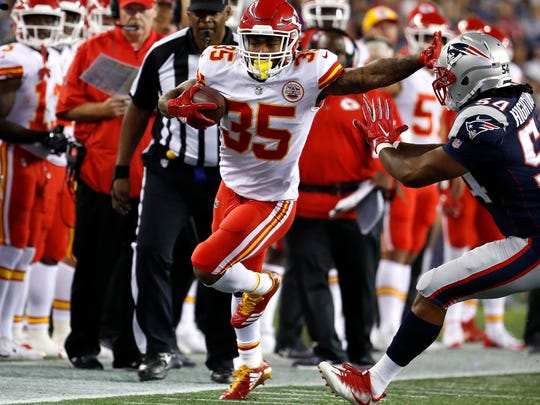 Kansas City Chiefs running back Charcandrick West, left, runs against the New England Patriots during an NFL football game at Gillette Stadium in Foxborough, Mass. Thursday, Sept. 7, 2017.