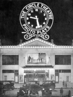 "This 1916 photos shows the Circle Theatre as it looked at night with the ""photo plays"" sign lit up."