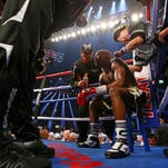 Floyd Mayweather Jr is tended to by trainers as he sits on the stool in his corner between rounds against Manny Pacquiao during a boxing fight at the MGM Grand Garden Arena. Sports ORG XMIT: USATSI-222852 ORIG FILE ID:  20150502_mjr_su5_006.JPG