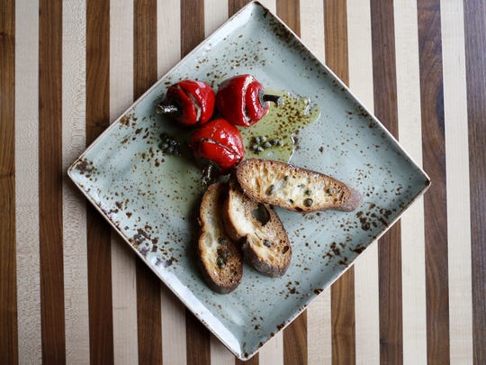 Forno's handcrafted cherry peppers are stuffed with tuna confit, capers and anchovy at Forno Osteria & Bar on Erie Avenue. The Enquirer/ Meg Vogel