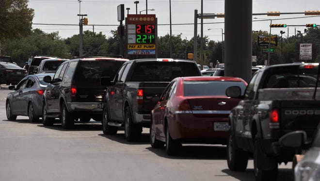 Vehicles line up across the H-E-B parking lot Thursday Aug. 31, 2017, to fill up at the grocery store's gas station. Across Abilene and outside the city, many gas stations saw unusually long lines as customers filled up, panicked by reports of shortages in other parts of the state.