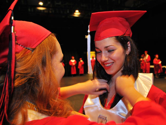 Edgewood Jr Sr High grads get ready for Saturday afternoon's graduation held at the Maxwell C. King Center for the Performing Arts in Melbourne.