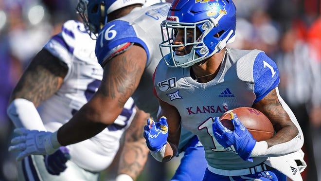 Kansas running back Pooka Williams Jr. (1) picks up first-half yardage against Kansas State in November, 2019, at Memorial Stadium in Lawrence.