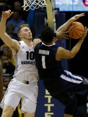 Marquette's Sam Hauser defends against Villanova's