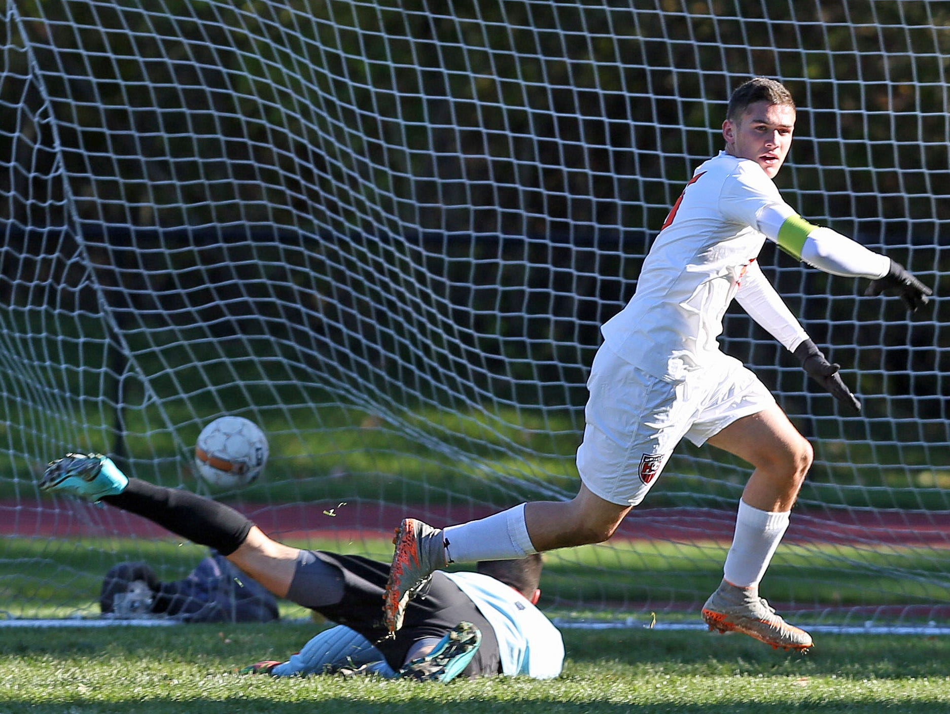 Greeley's Matt Neuberger (15) gets a shot pass North Rockland goal keeper Julio Rebolledo for his first of three goals in the first half during a boys soccer playoff game at Horace Greeley High School in Chappaqua Oct. 23, 2015.