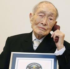 Sakari Momoi was born Feb. 5, 1903, in Fukushima prefecture, where he became a teacher.