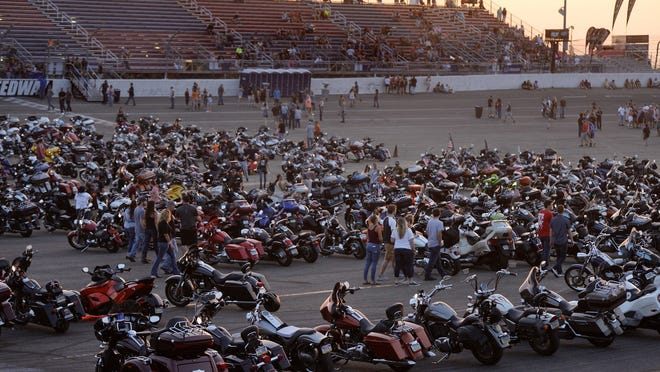 Motorcycles from the Bringin' in the Roar Parade park in the infield at Lake Erie Speedway in Greenfield Township on July 18, 2019, during the marquee event of the five-day Roar on the Shore motorcycle rally and charitable event. The Roar was not scheduled to take place this year even before the coronavirus pandemic, and its future remains undetermined.