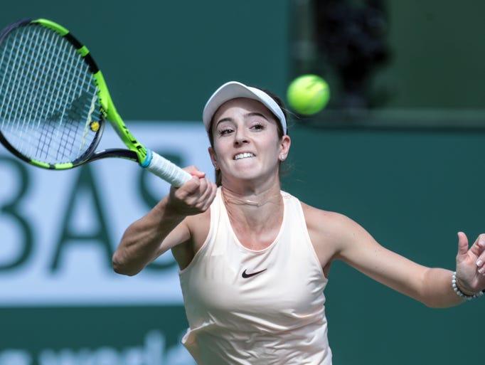 American Catherine Bellis returns the ball to Sara