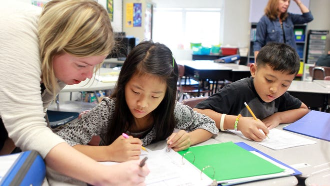 West Clermont school board member Jim Lewis questions the Common Core method of teaching math. Here, teacher Lisa Dickerman works with Rema Asad (left) and Bawi Sang in a fourth-grade math class at River Ridge Elementary School in Villa Hills.