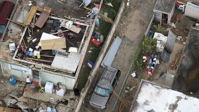 A damaged home is seen as people deal with the aftermath of Hurricane Maria on Sept. 25, 2017 in Levittown, Puerto Rico.