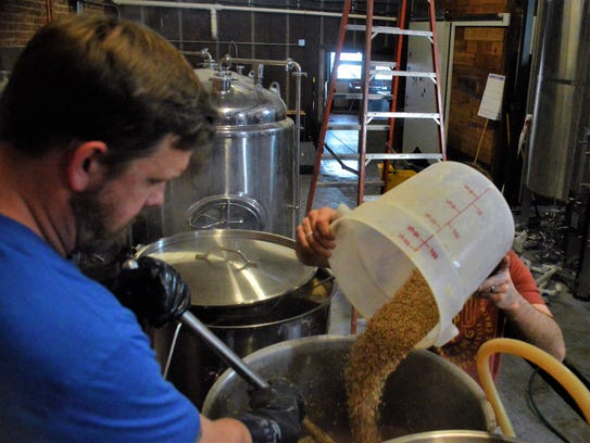 Grain is added during the mashing process at Red Gap Brewing Co.
