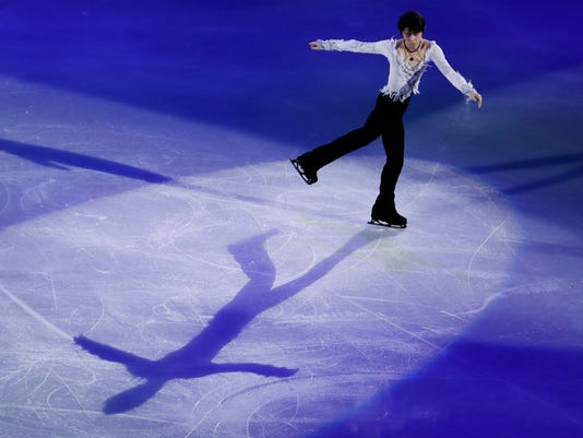 Yuzuru Hanyu of Japan performs during the figure skating exhibition gala in the Gangneung Ice Arena at the 2018 Winter Olympics in Gangneung, South Korea, Sunday, Feb. 25, 2018. (AP Photo/Felipe Dana)