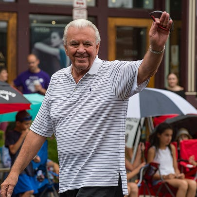 Oakland County Commissioner Bill Dwyer waves to the