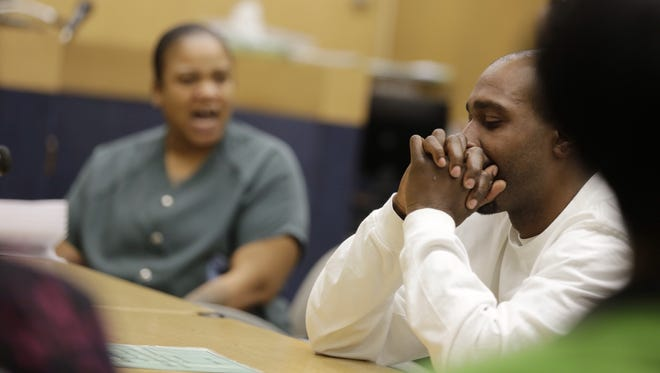 Mitchelle Blair screams at Alexander Dorsey, right the father of two of her children, saying that he is a drunk during a court appearance where the state is seeking to terminate their parental rights at the Wayne County juvenile court in Detroit on Wednesday April 8, 2015.