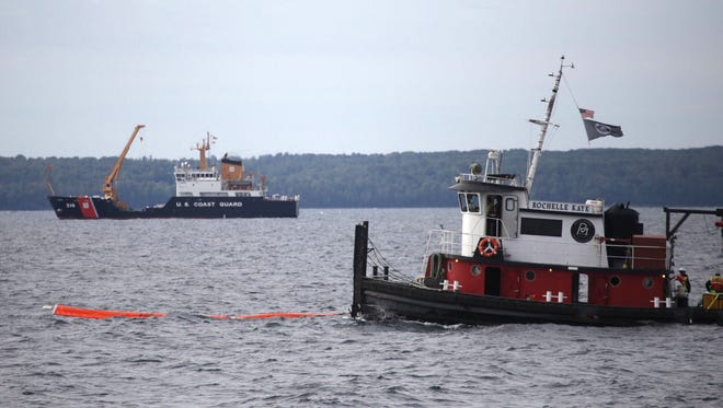 In the foreground is the tug Rochelle Kaye  and in the background the USCGC Alder, both ships that are part of a demonstration of boom deployment and shoreline cleanup assessment techniques during the Enbridge emergency response exercise at the Straits of Mackinac on Sept. 24, 2015.