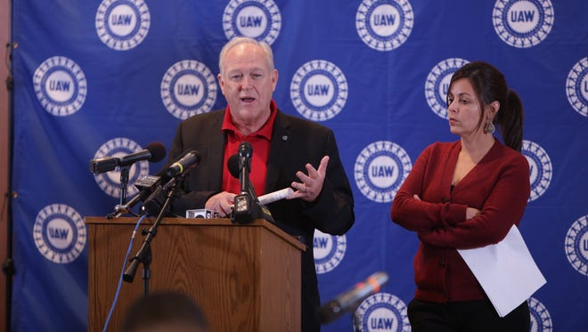 UAW President Dennis Williams and Vice President Cindy Estrada speak about a tentative agreement with General Motors on Wednesday, Oct. 28, 2015, during a press conference at the UAW-GM Center for Human Resources in Detroit.