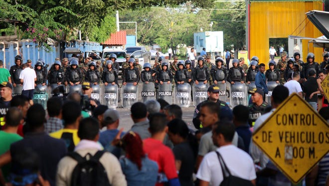 Nicaraguan police block Cuban migrants from crossing the border Nov. 16, 2015. Thousands of Cubans are stranded in Costa Rica as they try to make their way north to the USA, where they can present themselves to the Border Patrol and gain entry into the country.
