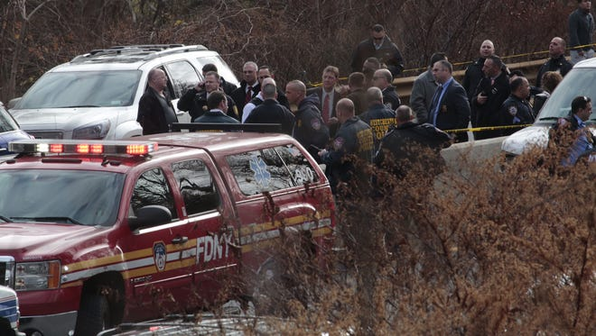 Police investigate a pursuit and crash that closed down the Saw Mill Parkway on Tuesday.