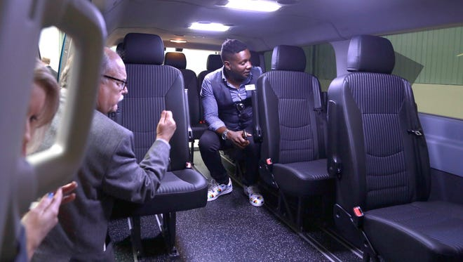 Media members get a look at the Go Ride Intelligent Shuttle Beta as part of the Ford Smart Mobility at the Ford Research and Innovation Center in Dearborn on Thursday December 10, 2015.