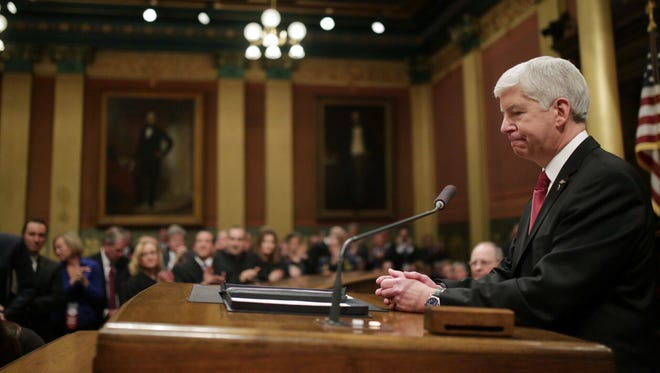Governor Rick Snyder addresses the Flint water crisis during his State of the State speech on Tuesday, Jan. 19, 2016, at the state Capitol building in Lansing.