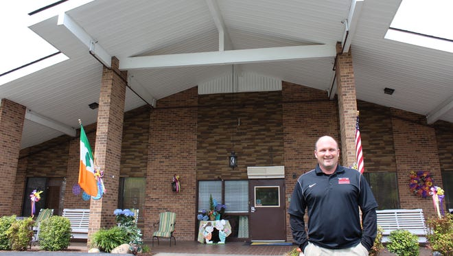 Barry Cotton, CEO/Administrator of Signature Healthcare stands near the home, excited about high marks on a survey by the State of Tennessee.