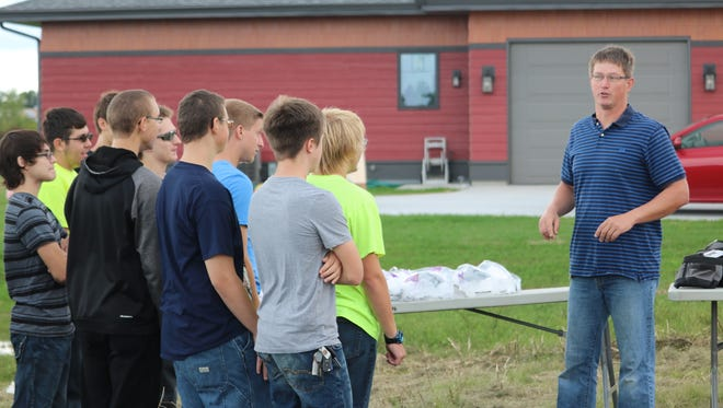Instructor Ted Schermetzler addresses the students at the groundbreaking on Wednesday, Sept. 14, for the 2016 residential house that North and South students will be building.