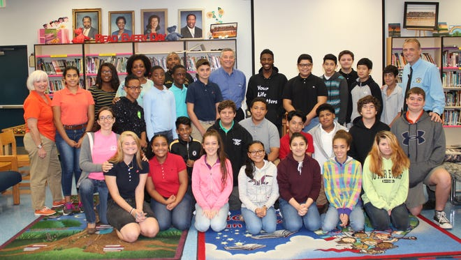 Dr. Donna and Kenneth Mills, school Superintendent Wayne Gent, Northport Principal Glenn Rustay, Assistant Principal Lisa Cash and eighth-grade students were thrilled with the Speaker's Bureau.