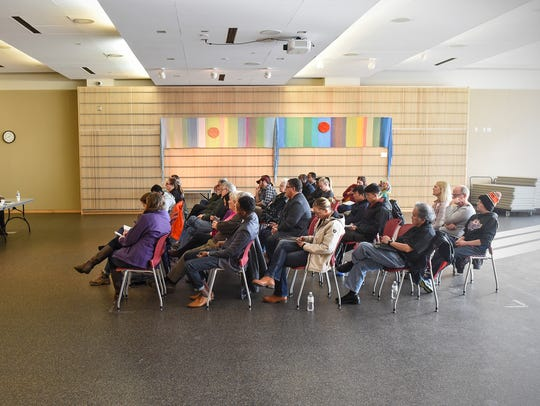 People gather for a panel discussion Saturday, Nov.