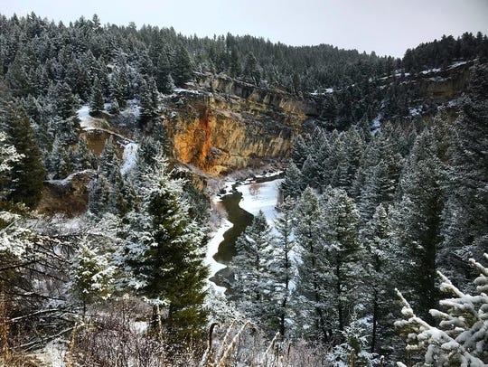 Partially frozen Belt Canyon Creek runs through the slot canyon at Sluice Boxes State Park near Belt.