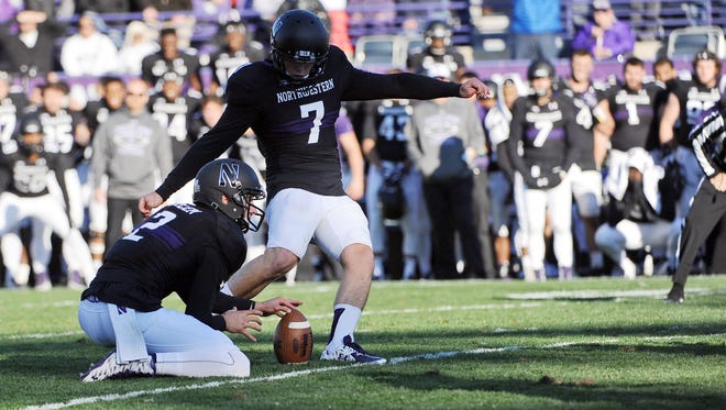 Northwestern place kicker Jack Mitchell (7) kicks the game-winning field goal in the closing seconds of the second half of an NCAA college football game against Penn State in Evanston, Ill.,  Saturday, Nov. 7, 2015.  Northwestern beat Penn State 23-21.