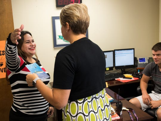 Spanish teacher Desiree Rodriguez hugs Carroll High Principal Kelly Manlove in her office as she comes in to check on her during the first day of school Tuesday, Sept. 5, 2017. Manlove, a Rockport resident, lost her home and belongings when Hurricane Harvey made landfall Aug. 25, 2017.