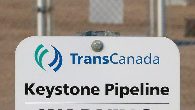FILE- This Nov. 6, 2015, file photo shows a sign for TransCanada's Keystone pipeline facilities in Hardisty, Alberta, Canada. TransCanada Corp.'s Keystone pipeline leaked oil onto agricultural land in northeastern South Dakota, the company and state regulators said Thursday, Nov. 16, 2017, but state officials don't believe the leak polluted any surface water bodies or drinking water systems.