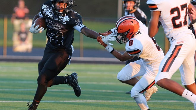 Joshua Lemon of Perry picks up yardage during their game against Hoover at Perry on Friday, Sept. 11, 2020. (CantonRep.com / Scott Heckel)\r
