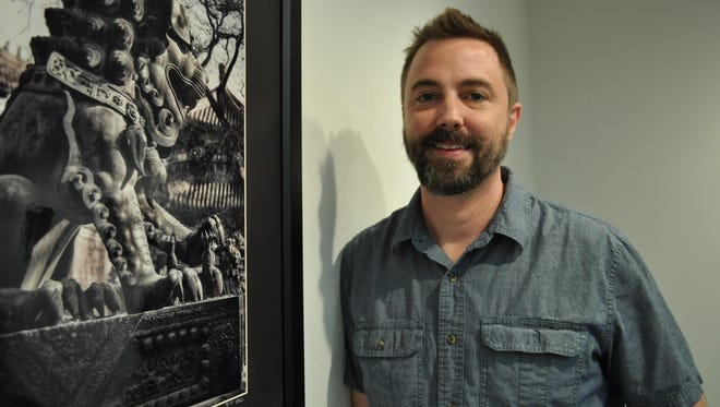 """Jonathan Clayton stands beside one of the photos that will be part of his """"Chinography"""" exhibit at Louisiana College through Sept. 17."""