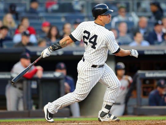 Yankees catcher Gary Sanchez (24) follows through on