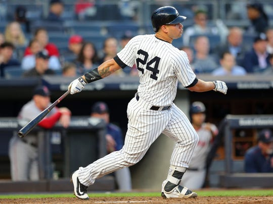 Yankees catcher Gary Sanchez (24) follows through on an RBI single against the Boston Red Sox during the fourth inning at Yankee Stadium on Wednesday, June 7, 2017.