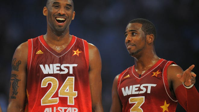 Feb 26, 2012; Orlando, FL, USA; Western Conference guard Kobe Bryant of the Los Angeles Lakers (24) talks to Chris Paul of the Los Angeles Clippers in the 2012 NBA All-Star Game at the Amway Center. Mandatory Credit: Bob Donnan-USA TODAY Sports