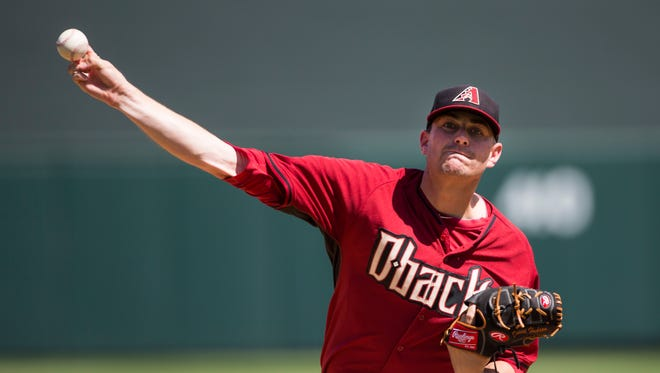 Arizona Diamondbacks pitcher Daniel Hudson delivers a pitch against the Colorado Rockies during spring training action at Salt River Fields at Talking Stick on March 29, 2015.