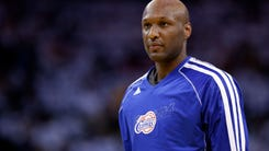FILE - This Jan. 2, 2013, file photo shows Los Angeles Clippers' Lamar Odom during an NBA basketball game against the Golden State Warriors in Oakland, Calif.  (AP Photo/Marcio Jose Sanchez, File)