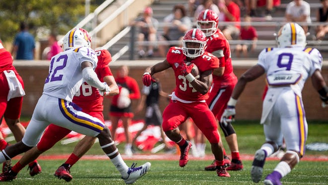 Ball State's James Gilbert drives the ball up the center during a fast run by Ball State Sept. 16 at Scheumann Stadium during their game against Tennessee Tech.