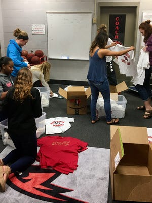 Rossview athletes pack up T-shirts to be sent to Houston for those affected by Hurricane Harvey on Wednesday.