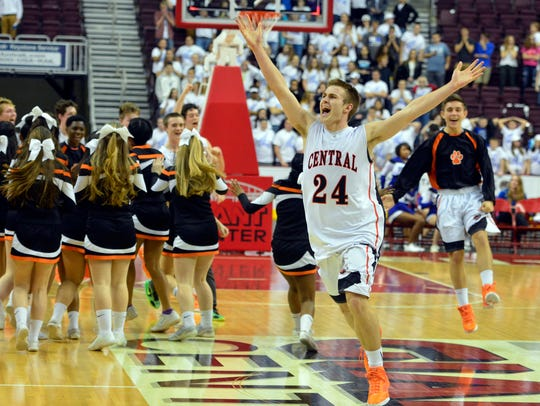 Central York's Jared Wagner celebrates after hitting the game-winning basket against Spring Grove in overtime during a District 3 Class 4-A semifinal on Tuesday Feb. 23, 2016. John A. Pavoncello photo