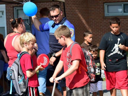 Kids interact with Matt Lynch of the Chambersburg Police.
