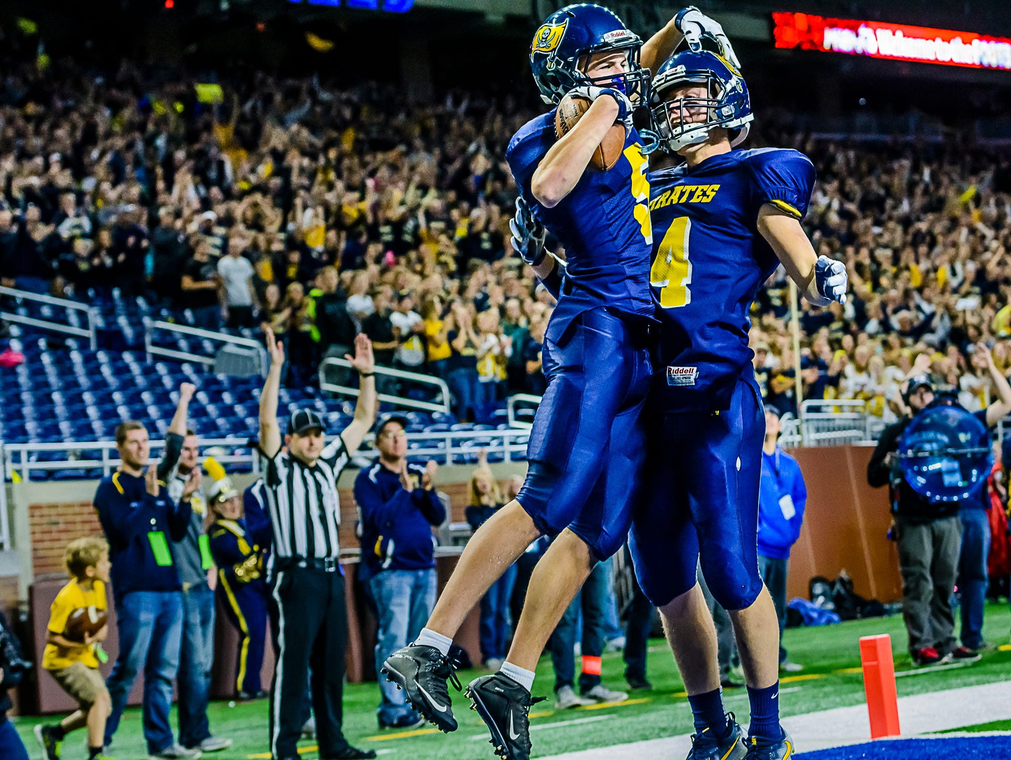 Logan Hengesbach ,left, of Pewamo-Westphalia celebrates with teammate Garrett Trierweiler after catching a pass for a touchdown to give the Pirates a 6-0 lead late in the 2nd quarter of their Division 7 state final game with Detroit Loyola Saturday November 26, 2016 at Ford Field in Detroit. KEVIN W. FOWLER PHOTO